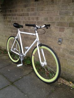 """Sleek gives you this latest creation - the sleek and slightly sick """"Slick"""". This clean cut fixie brings white paint and chrome fixings together, and with the aid of slightly sick looking lime green rims it is enabled to stand out and hold its own."""