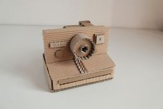 Cardboard cameras by Oupas Design, via Behance