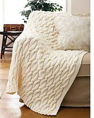 A Free Cable Knit Throw Pattern: Rated easy. Ravelry: Chunky Aran Cable Blanket pattern by Bernat Design Studio