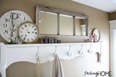 Transform a vintage footboard into a bathroom shelf/towel rack.