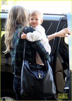 Gisele Bundchen Wants to Back Up Dance for Rihanna!: Photo Gisele Bundchen walks through LAX Airport with her adorable baby daughter Vivian in her arms on Sunday (February in Los Angeles. Tom Brady And Gisele, Gisele Bundchen, Celebrity Babies, Adriana Lima, Rihanna, Supermodels, Cute Babies, Celebrities, Celebs