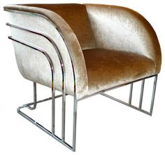 The rounded lines, sleek metalwork and champagne velour on this Milo Baughman chrome club chair would add deco glam to just about any room. — Noelani. Sold by 1stDibs