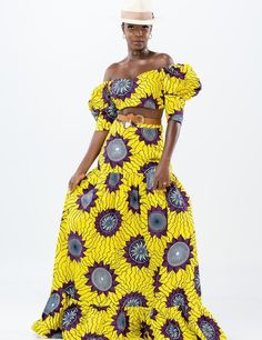 Relax on a sunny day in our African Print Ahuofe Crop Top and Skirt Set. This pretty maxi skirt has a draped, flowy shape with a flattering high waist. Covered in a vivid floral print, the skirt is perfect for dressing down in a t-shirt and sandals, or stepping out boldly with the matching crop top with your favorite heels for special occasions. Features: African Design Comfortable Feel Maxi Length Lightweight Fabric Ruffle hem Puff sleeve crop top Model wearing Size S African Design, Two Piece Outfit, Skirt Set, Floral Prints, Dressing, Couture, Crop Tops, Pretty, High Waist
