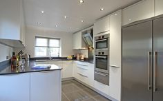 Rotpunkt Lucido White High Gloss Kitchen in Medstead, Hampshire. | German Kitchens | Bespoke Kitchens floor tiles