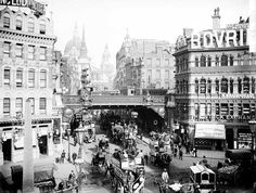 A busy street view of Ludgate Circus looking towards St Paul's Cathedral with horse-drawn buses in the foreground and a steam train on the bridge. The Circus was constructed at the junction of Ludgate Hill and Fleet Street between 1864 and Victorian London, Vintage London, Old London, London City, Victorian Era, London Style, Busy Street, London Boroughs, Fleet Street