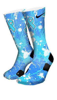Chances are everyone has a friend or a family member that has gone through cancer. This pair of custom elite socks features splashes of light blue which symbolizes prostate cancer awareness. Please su