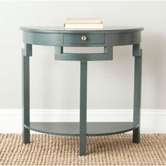 A handsome demilune table for an entry hall or living room wall, the Liana console is transitional with an industrial chic edge. Crafted of pine in a dark teal finish, Liana has a handy drawer and lower shelf for magazines or accessories. Grey Storage, Console Table, Wood Console Table, Grey Consoles, Safavieh Furniture, Beachcrest Home, Furniture, Sofa Tables, Home Collections