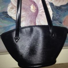 Louis Vuitton black Purse Authentic Authentic Louis Vuitton Epi black Purse. Made in Italy. Exterior condition Excellent, One owner.   Interior Gently used. Louis Vuitton Bags Shoulder Bags