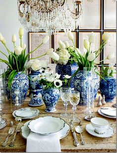 distressed farm table, vintage china and silver, blue and white porcelain containers.