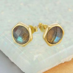 Beautiful and divine, these handmade round sterling silver 18ct gold plated stud earrings feature a hand-cut semi-precious labradorite stone. #Embersjewellery #Jewellery #accessories #giftforher #Labradorite