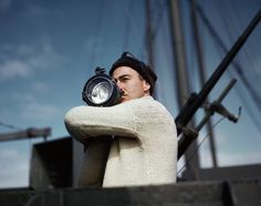 Robert Capa, [A crewman signals another ship of an Allied convoy across the Atlantic from the U.S. to England], 1942. © Robert Capa/International Center of Photography/Magnum Photos.