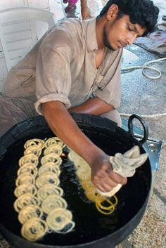 """Jalebi"" being cooked and sold at markets in Pakistan. Jalebi is a crisp desert best eaten hot. World Street Food, Street Food Market, Street Vendor, Pakistan Travel, World Recipes, Culture Travel, Indian Food Recipes, Brave, Golden Color"