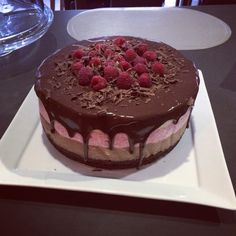 Triple layered chocolate, raspberry and honey mousse cake with a brownie base topped with ganache.