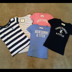 Tee shirt bundle XS-S Bundle of 5 tee shirts from Abercrombie. All washed and worn, excellent used condition. Gray/white shirt and navy blue shirt only worn once, other three worn a handful of times. The light blue and pink logo shirts show small about of pilling. Gray/white stripe and navy blue are S, other three are XS.no trades or paypal Abercrombie & Fitch Tops Tees - Short Sleeve