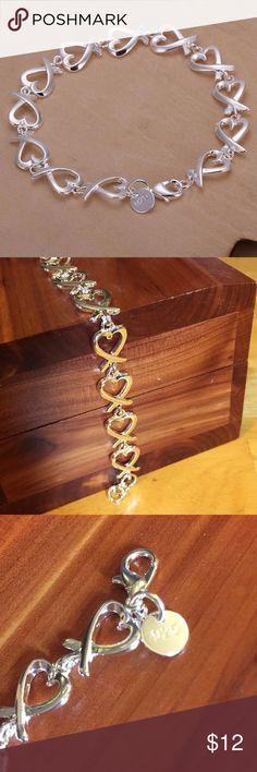 "Silver Heart Bracelet Silver 7"" bracelet. Hearts are approximately 3/8"" wide. Very pretty and dainty. Jewelry Bracelets"