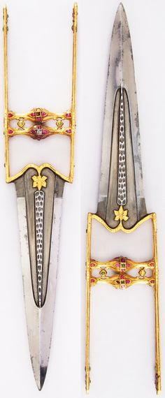 Indian katar, 18th century, detail view of the side bar and grip, L. with sheath 18 3/16 in. (46.2 cm); L. without sheath 17 in. (43.2 cm); W. 3 1/4 in. (8.3 cm); Wt. 16.4 oz. (464.9 g); Wt. of sheath 3.5 oz. (99.2 g), Met Museum, Bequest of George C. Stone, 1935. #56