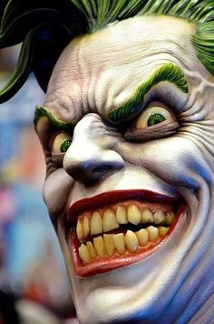 Joker = An insane, psychotic, lunatic madman with a crazy smile which is fit for a psychopathic clown.
