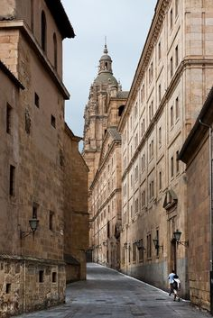 University of Salamanca, Spain...Working university founded in 13th century, with an ornate carved entrance and a  16th-century classroom.