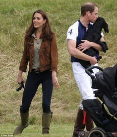 Prince William with his black cocker spaniel, Lupo, at the Beaufort Polo Club in Gloucestershire, June 17, 2012.