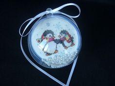 Penguin snow globe ornament.