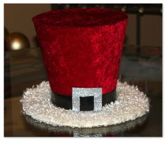 "Santa Claus top hat, 7"" Christmas Hat, Candy cane, Christmas tree topper, Christmas table decoration. $26.00, via Etsy."