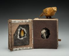 Michael Essig - FETISH-BIRD.  Holly, koa, handmade paper, mica, fossils, shell, feather, ambrotype, leather, brass, Ethiopian and Coptic bindings, 4.25x3.5x2.5 inches