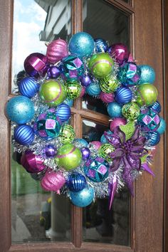 Christmas Ornament Tisel Wreath, Purple, Blue, Pink and Green. $80.00, via Etsy.