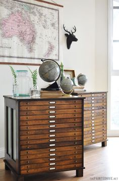 Wish I had a map drawer cabinet - aren't they incredible!  Makeover Trend-Library Influence-The Painted Hive