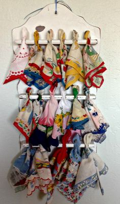 Vintage Hankies on an old spoon rack from Perfectly Printed. I LOVE This idea!