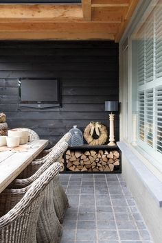 The black accent slat wood wall, tiles, and natural wood elements. Home And Garden, Garden Room, Home, House, Outdoor Rooms, Outside Living, Outdoor Decor, New Homes, Outdoor Dining