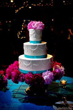 Beautiful blue and pink wedding cake. Photo by Studio 563. Rentals provided by Austin Texas Wedding and Event Rental Professionals, Premiere Party Central: http://www.PremierePartyCentral.com