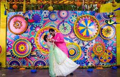 Mela themed mehndi, sangeet ceremony at wedding. It had all you could think of in a destination wedding. It had a vibrant photobooth, DIY ideas by the bride