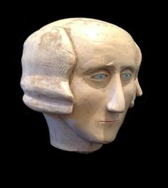 Early folk art carved bust of George Washington. Found as a finial on the top of a staircase in an old farmhouse in Sneedville, Tennessee..Anonymous Works