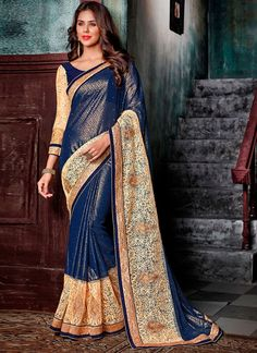 Unique elegance can come out through the dressing design with this blue faux georgette designer saree. You could see some interesting patterns completed with resham and zari work. Comes with matching ...