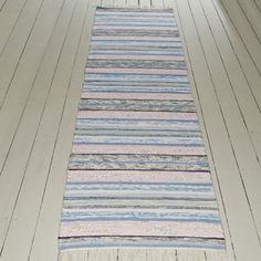 A beautifully made handwoven rug made with soft coloured fabrics. 100% Cotton. Dry cleaning recommended.