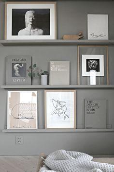 warm grey art and book wall
