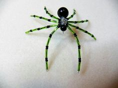 Green and black beaded spider