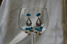 silver tone earrings.$24  Rossana Santis jewelry designer.facebook