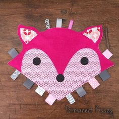 Fox Tag Toy for baby with appliquéd features, ribbon tags, and flannel back