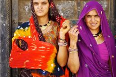 portrait of two farm workers, at home in their village in rural Rajasthan, India