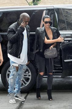 June 1, 2015 - Kim Kardashian + Kanye West arriving at their apartment in New York City.