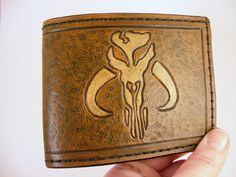 SovaLeatherworks on Etsy - some of the most amazing wallets I have ever seen.