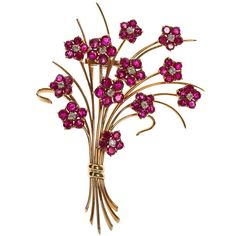 "VAN CLEEF & ARPELS Vintage 1950s French Flower Ruby Brooch. A fine vintage 1950s 14k yellow gold French flower bouquet brooch with rubies. 3 -1/4"" tall. ~7.00cts of rubies, ~1.20cts diamonds by Van Cleef & Arpels."