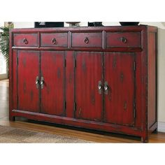 """$1142  Rich, red finish  Constructed from hardwood solids & veneers  Handpainted  Four drawers  One adjustable shelf  Overall dimensions: 40.25"""" H x 58.25"""" W x 15.5"""" D"""
