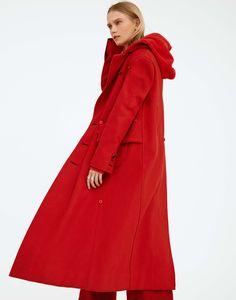 Kim Shui's velour cotton jersey hoodie under Homic's felt cashmere coat. Cornelia Webb ring; Catbird rings.