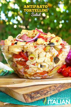 My lastest summer obsession is a fusion of your favorite antipasto together with a pasta salad tossed with an amazing homemade zippy Italian dressing that will make your tastebuds sing. This easy recipe for Antipasto Tortellini Salad will become your new favorite. I can't stop eating it, it's so good! Get the recipe at TheSlowRoastedItalian.com @SlowRoasted