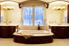 I love the SEPERATE his and her sinks with tub in the window.