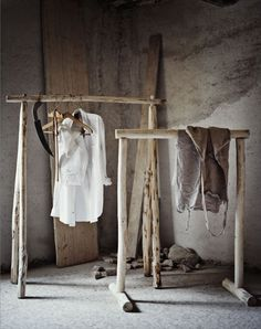 Clothing racks made from branches...these are awesome