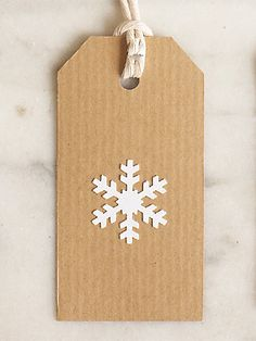 Make a white snowflake Christmas gift tag