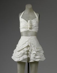 Two-piece bathing suit, late 1940's, American. Made of synthetic material. Beachwear style followed women's wear by the fully gathered skirts.